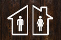 Paper house with man and woman inside. Divorce concept Royalty Free Stock Photo