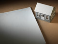Paper houses house and sheet of on the table Stock Photography
