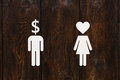 Paper man dollar head and woman with heart. Love vs money concept Royalty Free Stock Photo