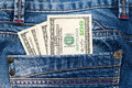 Paper money in the pocket of jeans Royalty Free Stock Photo