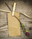 Paper note with dried rose on a old wooden boards Royalty Free Stock Photo