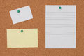 Paper note with pushpin on cork board background Royalty Free Stock Photo