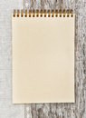 Paper notebook and linen fabric on the old wood spiral wooden background Royalty Free Stock Photo