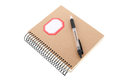 Paper notebook with pencil isolated over white background Royalty Free Stock Photography