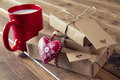 Paper parcels wrapped tied with tags some a milk mug for santa a red heart and some christmas gift boxes kraft Royalty Free Stock Photography