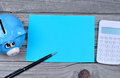 Paper with pen and piggybank on wooden table Royalty Free Stock Photo