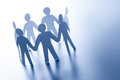Paper people standing together hand in hand. Team, glabal business connection concept Royalty Free Stock Photo