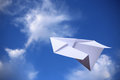 Paper plane with blue sky flying in the Stock Photos