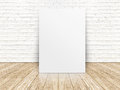 Paper poster on the white  brick wall and the wood floor,templat Royalty Free Stock Photo
