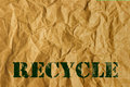 Paper with recycled text on blank wrinkled save the world concept Royalty Free Stock Photos