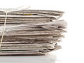 Paper recycling tied up stack of old newspapers collected for on white background Royalty Free Stock Image