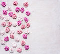 Paper roses of different colors stacked  white wooden background, valentines day Royalty Free Stock Photo