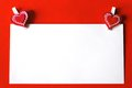 Paper sheet with heart shaped clips on red background white two clip Stock Image