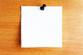 Paper sheet with pin on mdf panel Royalty Free Stock Image