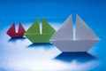 Paper Ships Sailing on Blue paper sea. Origami Boat. Paper Sea Royalty Free Stock Photo