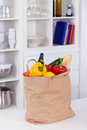 Paper shopping bag full food kitchen counter Royalty Free Stock Photography