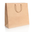 Paper shopping bag with handles over white background Stock Images