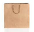 Paper shopping bag with handles over white background Stock Photography