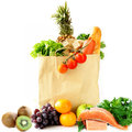 Paper shopping bag with vegetables and fruits, berries Royalty Free Stock Photo