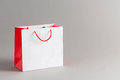 Paper shopping bag white and red color isolated on gray background Stock Images