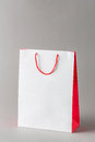 Paper shopping bag white and red color isolated on gray background Royalty Free Stock Image