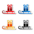 Paper sledge with gift, sticker Royalty Free Stock Image