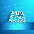 Paper snowflake effect shape in blue background Royalty Free Stock Photography