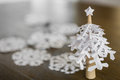 Paper snowflakes christmas tree on wood table Royalty Free Stock Photo