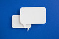 Paper speech bubble on blue background Royalty Free Stock Photos