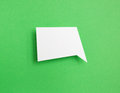 Paper speech bubble on green background Royalty Free Stock Photography