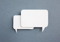 Paper speech bubble on grey background Royalty Free Stock Photo