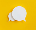 Paper speech bubble on yellow background Stock Images