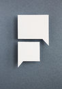 Paper speech bubbles on grey background Stock Image