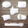 Paper speech bubbles over wooden background Royalty Free Stock Image