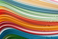 Paper strips in rainbow colors as a colorful backdrop on white Royalty Free Stock Photos