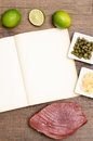 Paper with text space and tuna fish and ingredients on a wooden table Stock Photo