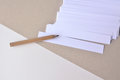 Paper white stripes for notes with pencil on a paper background Royalty Free Stock Photo