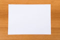 Paper on wood top view of blank white background Royalty Free Stock Photography