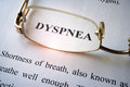 Paper with word dyspnea. Royalty Free Stock Photo