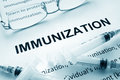 Paper with word immunization and glasses Stock Photos