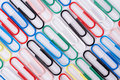 Paperclips colourful lined up on white Royalty Free Stock Photo