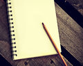Papers in a copybook with pen on wooden table white blank the desk Royalty Free Stock Image