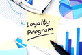 Papers with graphs and Loyalty Program concept. Royalty Free Stock Photo
