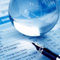 Paperweight and pen on report Royalty Free Stock Photo