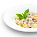 Pappardelle with sweet pear and walnuts hot tasty italian decorated basil leaf on white Royalty Free Stock Photography