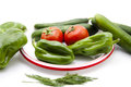 Paprika and cucumbers with tomatoes on plate and on white background Royalty Free Stock Photo