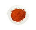 Paprika ground on a plate isolation on a white background Royalty Free Stock Photo