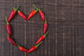Paprika red pepper in the shape of heart. The texture on a wooden background. Valentine's Day. Royalty Free Stock Photos