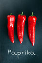 Paprika three paprikas on black background Royalty Free Stock Image