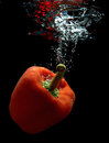 Paprika in water plunged into with air bubbles ascending Royalty Free Stock Photo